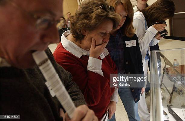 Michelle Spivak grimaced as she looked at the large collection of weapons Eric harris and Dyland Klebold brought to school the day of the shootings....