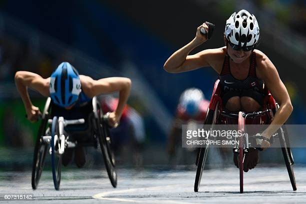 TOPSHOT Michelle Stilwell of Canada celebrates after winning the 100M T52 wheelchair race at the Paralympic Games in Rio de Janeiro Brazil on...