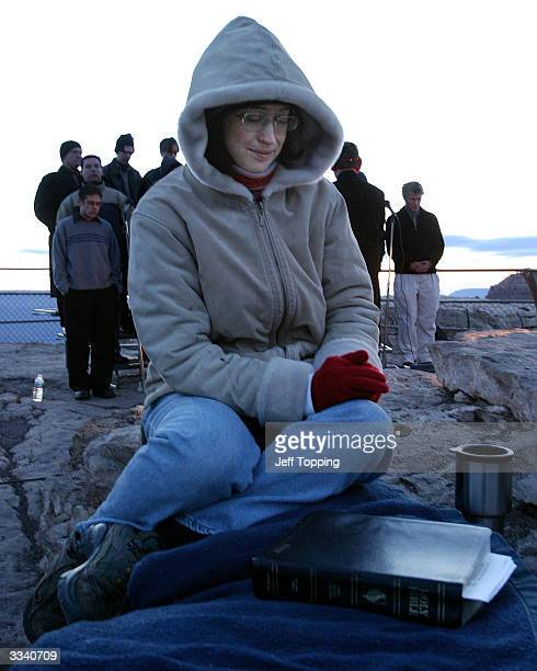 Michelle Strating prays during Easter sunrise service on Mather Point at the south rim of the Grand Canyon in Arizona April 11 2004 Approximately 800...