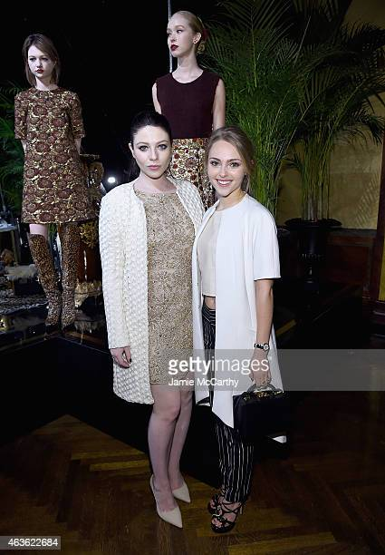 Michelle Trachtenberg and AnnaSophia Robb attend the Alice Olivia presentation during MercedesBenz Fashion Week Fall 2015 on February 16 2015 in New...