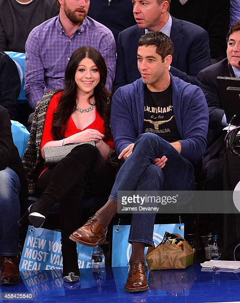 Michelle Trachtenberg and Nick Loeb attend the Washington Wizards Vs New York Knicks game at Madison Square Garden on November 4 2014 in New York City