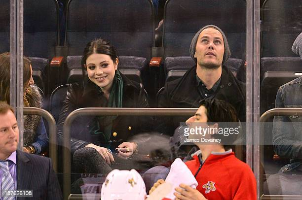 Michelle Trachtenberg and Taylor Kitsch attend the Carolina Panthers vs New York Rangers game at Madison Square Garden on November 10, 2013 in New...