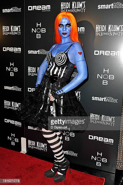 Michelle Trachtenberg attends Heidi Klum's 12th annual Halloween party at the PHD Rooftop Lounge at Dream Downtown on October 31 2011 in New York City