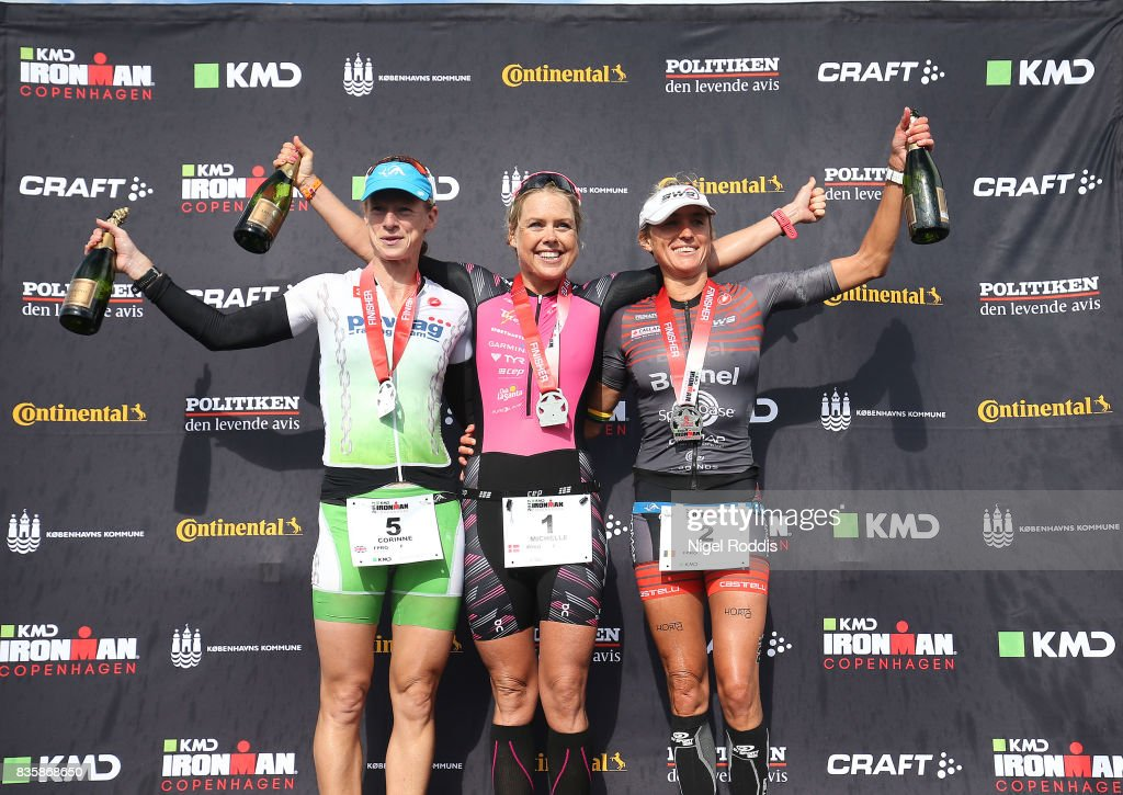 Michelle Vesterby (C) of Denmark in 1st position, Corinne Abraham (L) of Great Britain in 2nd position and Christina Svejstrup (R) in 3rd position of Denmark celebrate their results after finishing KMD IRONMAN Copenhagen on August 20, 2017 in Copenhagen, Denmark.