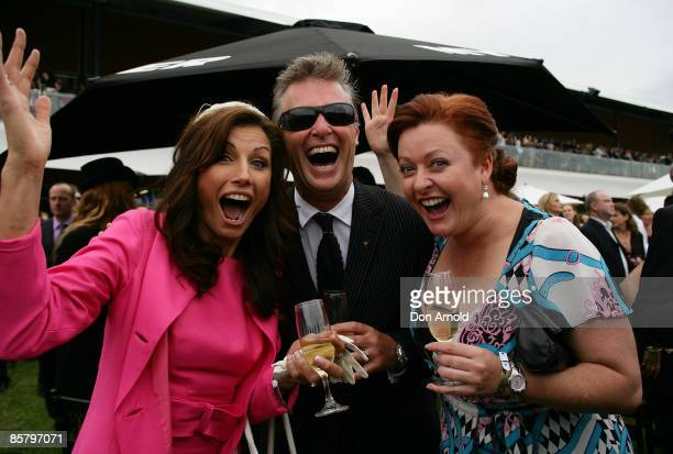 Michelle Walsh Martin Walsh and Shelley Horton attend the Golden Slipper Day 2009 at Rosehill Gardens on April 4 2009 in Sydney Australia