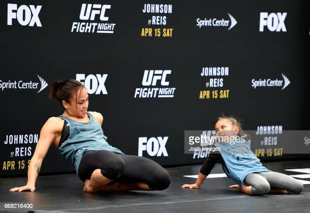 Michelle Waterson alongside daughter Araya holds an open workout for fans and media at the Kansas City Power Light District on April 13 2017 in...