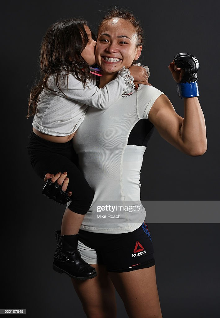 Michelle Waterson and daughter Araya pose for a portrait backstage after her victory over Paige VanZant during the UFC Fight Night event inside the Golden 1 Center Arena on December 17, 2016 in Sacramento, California.