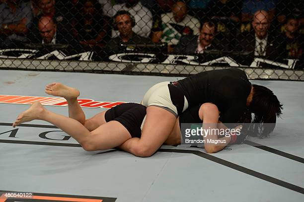 Michelle Waterson attempts to submit Angela Magana in their women's strawweight bout during the Ultimate Fighter Finale inside MGM Grand Garden Arena...