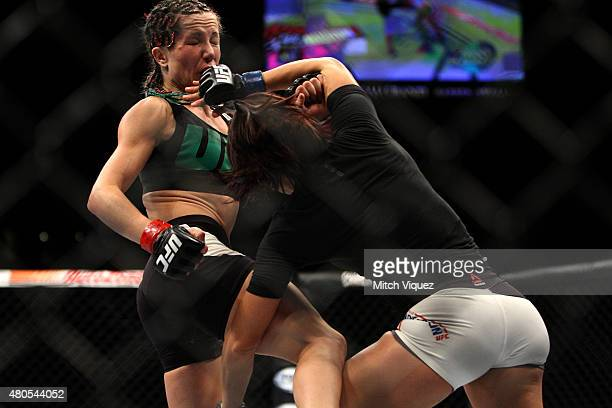Michelle Waterson attempts to take down Angela Magana in their women's strawweight bout during the Ultimate Fighter Finale inside MGM Grand Garden...