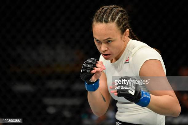 Michelle Waterson battles Carla Esparza in their strawweight fight during the UFC 249 event at VyStar Veterans Memorial Arena on May 09, 2020 in...