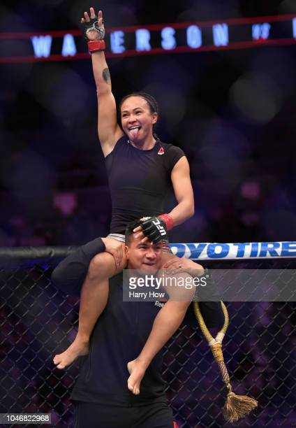 Michelle Waterson celebrates defeating Felice Herrig after their women's strawweight bout during the UFC 229 event inside TMobile Arena on October 6...