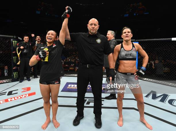 Michelle Waterson celebrates her victory over Cortney Casey in their womens strawweight fight during the UFC Fight Night event at the Gila Rivera...