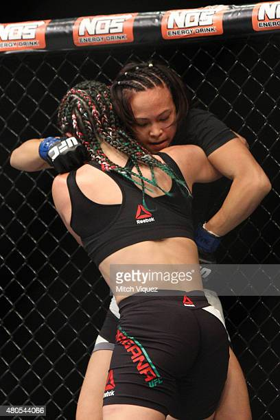 Michelle Waterson grapples with Angela Magana in their women's strawweight bout during the Ultimate Fighter Finale inside MGM Grand Garden Arena on...