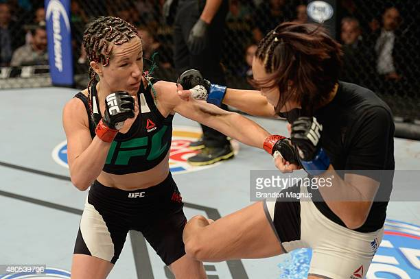 Michelle Waterson kicks Angela Magana in their women's strawweight bout during the Ultimate Fighter Finale inside MGM Grand Garden Arena on July 12...