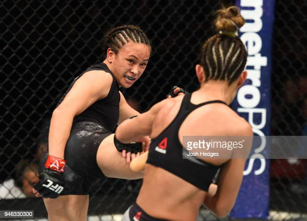 Michelle Waterson kicks Cortney Casey in their womens strawweight fight during the UFC Fight Night event at the Gila Rivera Arena on April 14 2018 in...