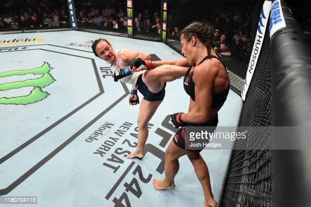 Michelle Waterson kicks Joanna Jedrzejczyk of Poland in their women's strawweight bout during the UFC Fight Night event at Amalie Arena on October 12...