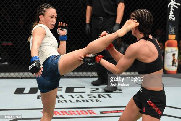 Michelle Waterson kicks Karolina Kowalkiewicz of Poland in their women's strawweight bout during the UFC Fight Night Event event at Wells Fargo...