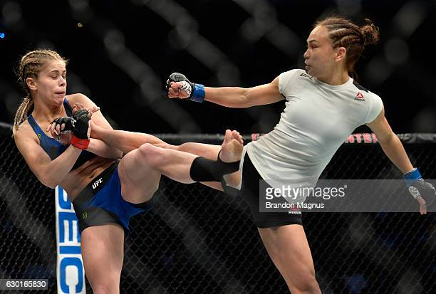 Michelle Waterson kicks Paige VanZant in their women's strawweight bout during the UFC Fight Night event inside the Golden 1 Center Arena on December...