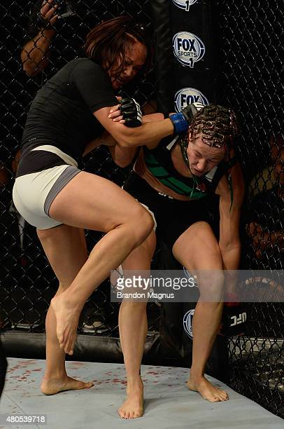Michelle Waterson knees Angela Magana in their women's strawweight bout during the Ultimate Fighter Finale inside MGM Grand Garden Arena on July 12...