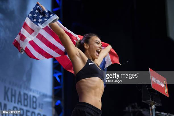 Michelle Waterson poses on the scale during the UFC 229 weighin inside TMobile Arena on October 5 2018 in Las Vegas Nevada