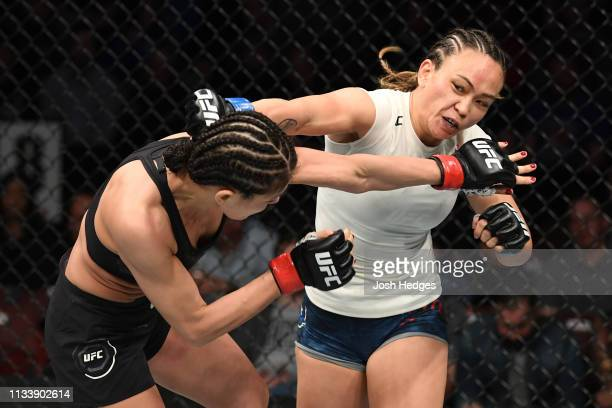 Michelle Waterson punches Karolina Kowalkiewicz of Poland in their women's strawweight bout during the UFC Fight Night Event event at Wells Fargo...