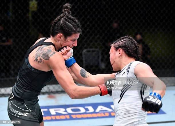 Michelle Waterson punches Marina Rodriguez of Brazil in a flyweight fight during the UFC Fight Night event at UFC APEX on May 08, 2021 in Las Vegas,...