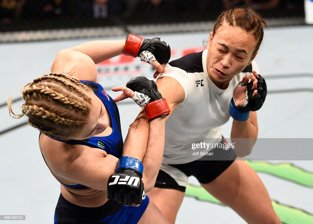 Michelle Waterson punches Paige VanZant in their women's strawweight bout during the UFC Fight Night event inside the Golden 1 Center Arena on December 17, 2016 in Sacramento, California.