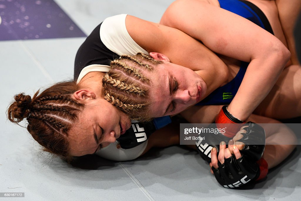 Michelle Waterson secures a rear choke submission against Paige VanZant in their women's strawweight bout during the UFC Fight Night event inside the Golden 1 Center Arena on December 17, 2016 in Sacramento, California.