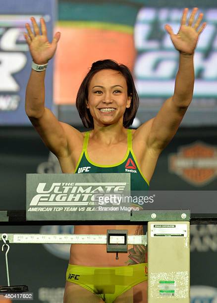 Michelle Waterson steps onto the scale during the TUF 21 Finale Weighin at the UFC Fan Expo in the Sands Expo and Convention Center on July 11 2015...