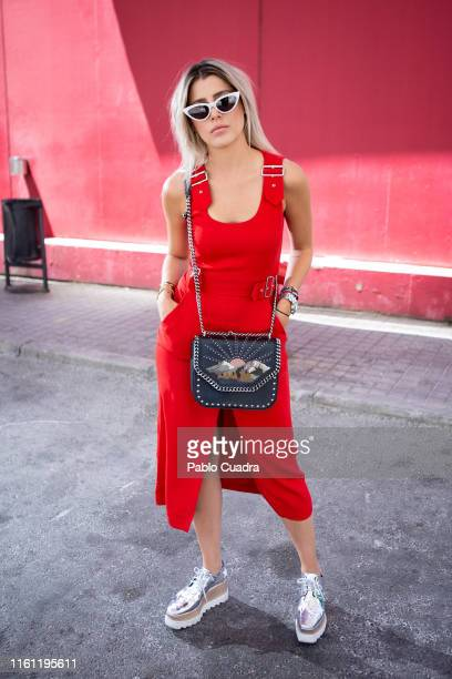 Michelle wears Stella McCartney shoes and hanbag, ALC dress and My My My sunglasses during Mercedes Benz Fashion Week Madrid Sprint/Summer 2020 at...