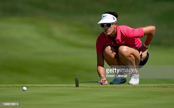 Michelle Wie aims for a putt during the final round of the PG NW Arkansas Championship at the Pinnacle Country Club on September 12 2010 in Rogers...