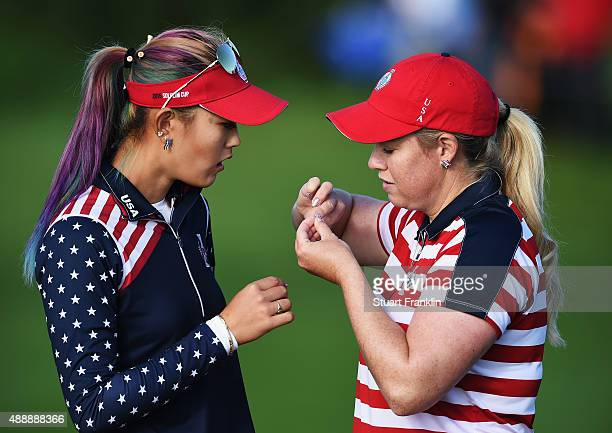Michelle Wie and Brittany Lincicome of team USA check their finger nails during the morning foursomes The Solheim Cup at St LeonRot Golf Club on...