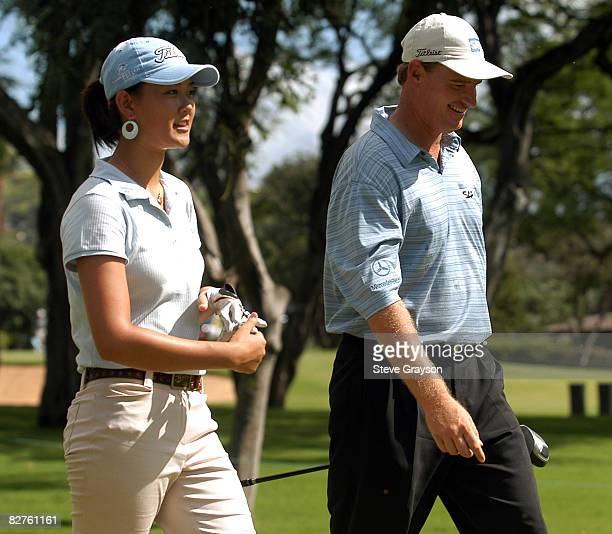 Michelle Wie and Ernie Els in action during their practice round at the 2004 Sony Open