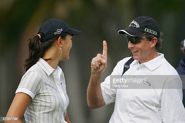 Michelle Wie and her coach David Leadbetter during a practice round of the Sony Open at the Waialae Country Club on January 10 2006 in Honolulu Hawaii