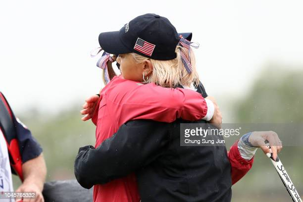 Michelle Wie and Jessica Korda of the United States celebrate their victroy on the 14th green in the Pool B match between USA and Thailand on day two...