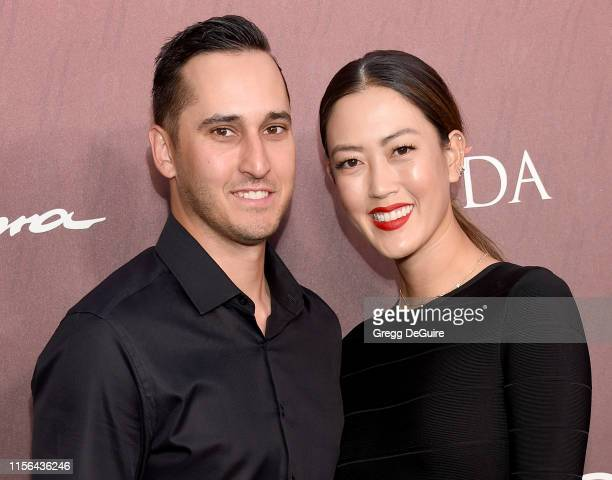 Michelle Wie and Jonnie West arrive at the Sports Illustrated Fashionable 50 at The Sunset Room on July 18 2019 in Los Angeles California