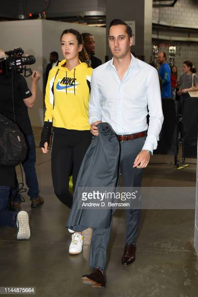 Michelle Wie and Jonnie West arrive before Game Three of the Western Conference Finals between the Golden State Warriors and the Portland Trail...