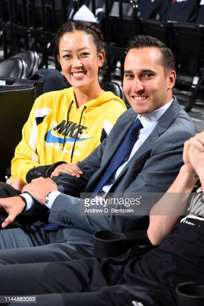 Michelle Wie and Jonnie West pose for a photo before Game Three of the Western Conference Finals between the Golden State Warriors and the Portland...