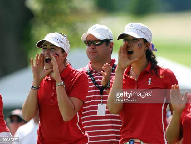 Michelle wie and Paula Creamer encourage fellow team members on the 18th hole during the Sunday singles matches at the 2009 Solheim Cup Matches at...
