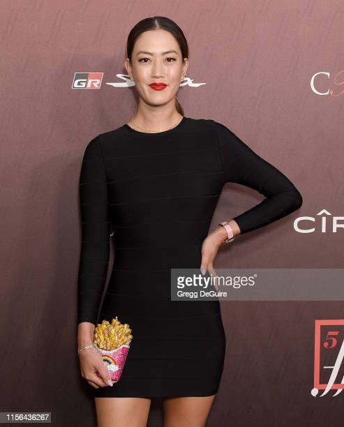 Michelle Wie arrives at the Sports Illustrated Fashionable 50 at The Sunset Room on July 18, 2019 in Los Angeles, California.