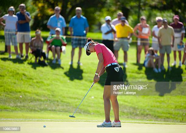 Michelle Wie attempts a putt on the 16th hole during the final round of the PG NW Arkansas Championship at the Pinnacle Country Club on September 12...