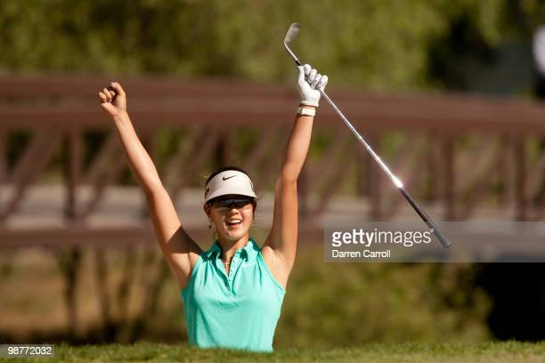 Michelle Wie celebrates after holing a bunker shot for par on the 16th hole during the second round of the Tres Marias Championship at the Tres...