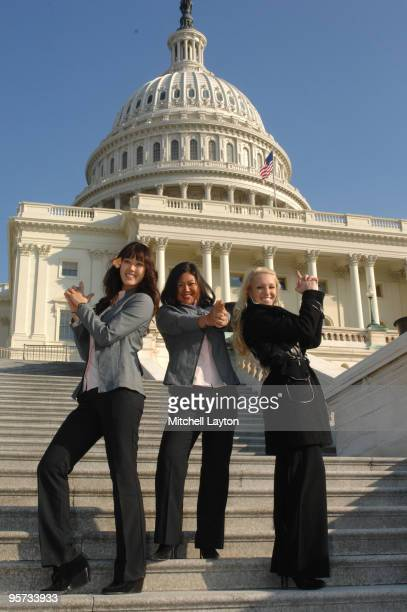 Michelle Wie Christina Kim and Natalie Gulbis of the 2009 United States Solheim Team poses for photo in front the Capital during visit to celebrate...