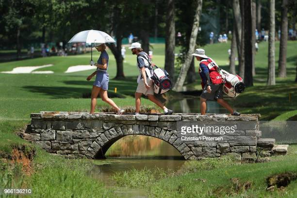 Michelle Wie crosses the second hole bridge during the third round of the 2018 US Women's Open at Shoal Creek on June 2 2018 in Shoal Creek Alabama