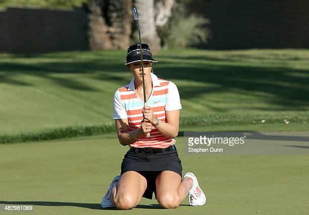 Michelle Wie drops to her knees in reaction to just missing a birdie putt attempt on the 15th hole during the third round of the Kraft Nabisco...