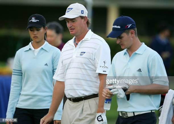 Michelle Wie Ernie Els of South Africa and Justin Rose of England walk off the tenth tee during a practice round prior to the start of the Sony Open...