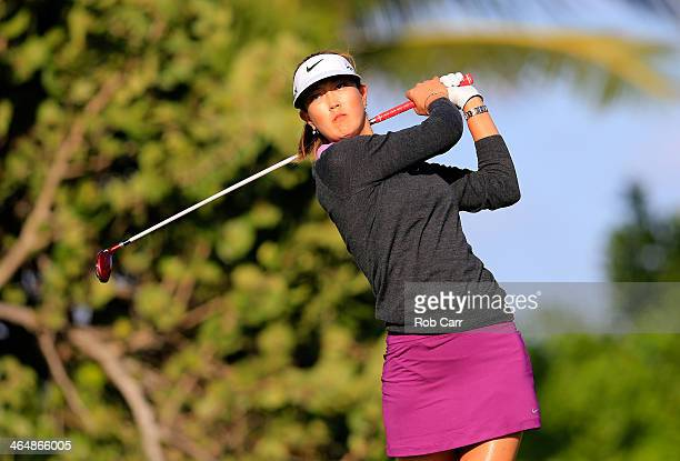 Michelle Wie follows her drive on the fourth hole during round two of the Pure Silk Bahamas LPGA Classic at the Ocean Club course on January 24 2014...