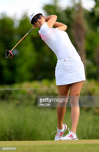 Michelle Wie follows her tee shot on the fourth hole during round one of the Pure Silk Bahamas LPGA Classic at the Ocean Club course on January 23...