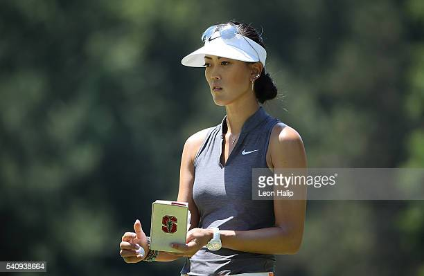 Michelle Wie from the United States check her book on the 7th hole during the second round of the Meijer LPGA Classic on June 17 2016 at Blythefield...
