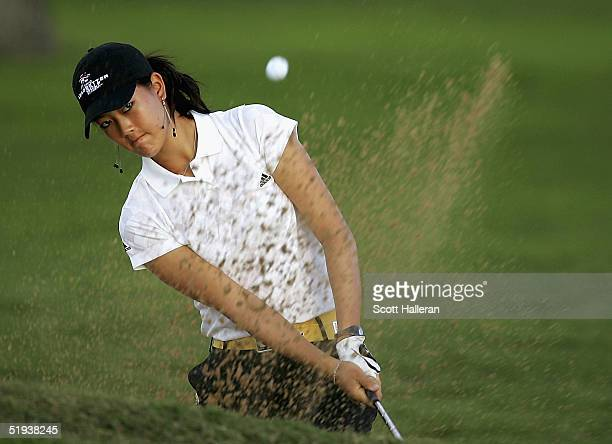 Michelle Wie hits a bunker shot during a practice round prior to the start of the Sony Open at the Waialae Country Club on January 11 2005 in...